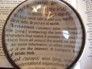 Dictionary through lens via wikimedia commons